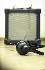 Headphones and guitar amplifier