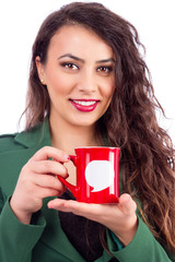Closeup portrait of a happy businesswoman holding a cup of coffe