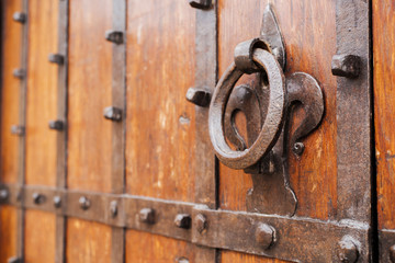 iron knocker on an old door of a monastery