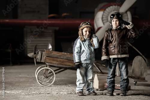 Young aviators in homemade aircraft in a large hangar
