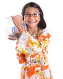 Young asian girl with money jar over white background