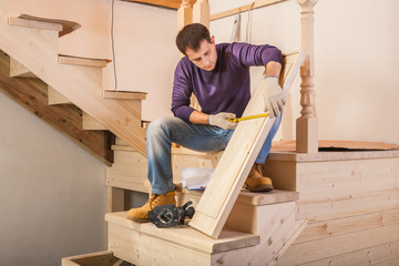 carpenter measuring step of ladder