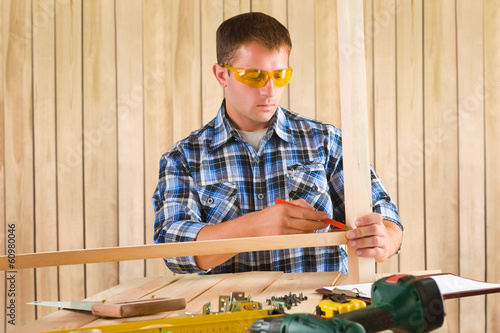 carpenter working at table