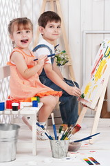 Little boy and girl painted in his studio