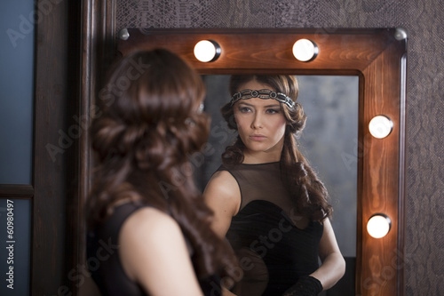 Mirror reflection of a young caucasian woman