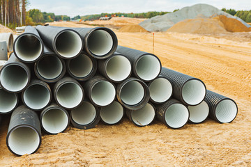 pile of big pipes on construction site