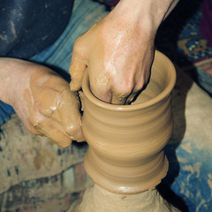 artist making hand made pottery