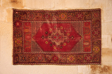 traditional asian carpet hanged on wall