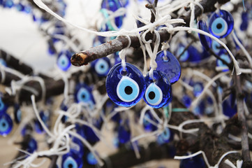 blue evil eyes hanged on tree
