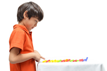 Little boy playing domino fall down on white background