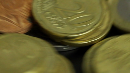 Euro coins spinning, close up macro shot