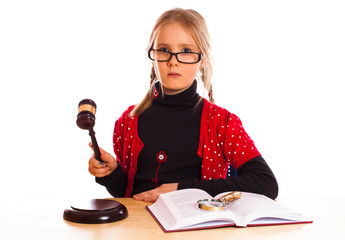 Pretty  little girl and law gavel isolated on white