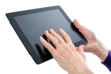 old hand on  digital tablet