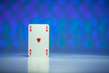 Red heart Ace playing card with blue background