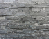 Modern stone wall constructed with stone plates