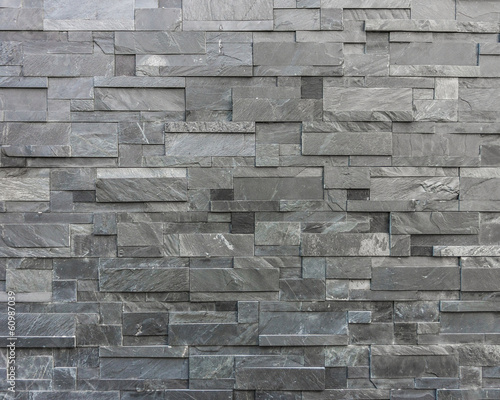 Modern stone wall constructed with stone plates - 60987039