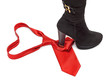 Boot steps on a necktie