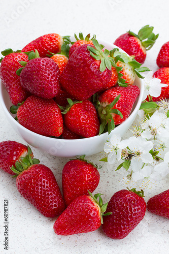Plate of strawberries  with spring twigs