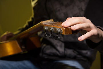 Close-up of a man with a guitar.