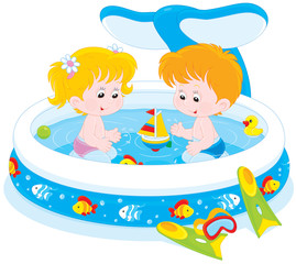 girl and boy playing in an inflatable paddling pool