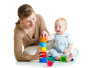 kid and mother playing together with toys