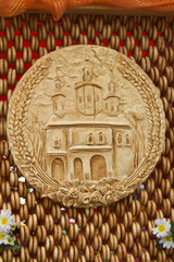 Bread, decorated with the image of the temple, is situated on th