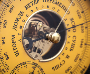 Closeup fragment of vintage yellow Russian barometer