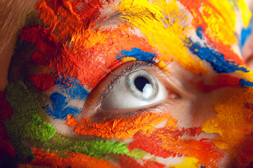 close up photo of female eye with paints
