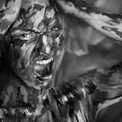 desaturated portrait of emotional woman in paints