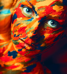 Portrait of adult woman with paint strokes on face
