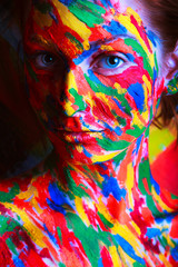 skin of girl in colourful paint