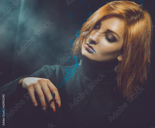 emotional photo of woman with cigarette