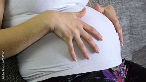 Pregnant woman touching belly