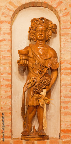 Bakchus carved statue from wine cellar.