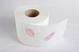 Lipstick prints on toilet tissue roll