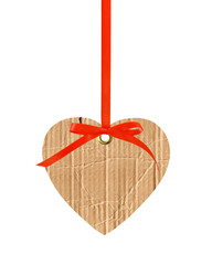 cardboard heart with red ribbon bow isolated on white
