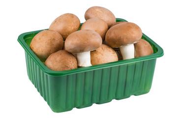 champignon mushrooms in a plastic basket
