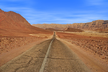 Road and red mountains in Timna park.