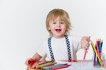 Happy kid drawing colorful paintings with bright pencils