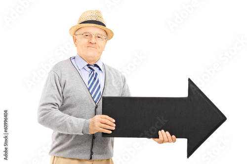 Senior gentleman holding big black arrow pointing right