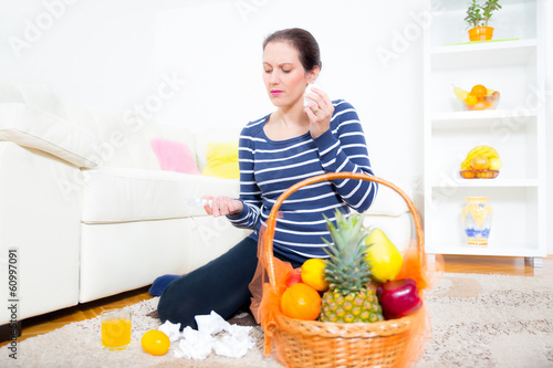 woman with a cold holding pills