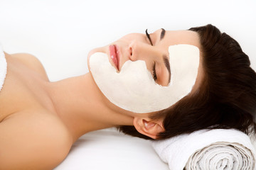 Spa Mask. Woman in Spa Salon. Face Mask. Facial Clay Mask.