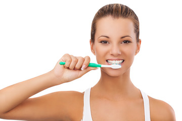 Portrait of beautiful young girl starting to brush her teeth