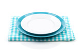 Empty plates over kitchen towel
