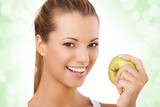 Beautiful smiling young woman holding apple