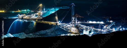 machine in an open coal mine at night - 60998634
