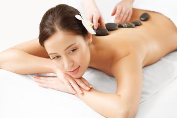 Stone Massage. Beautiful Woman Getting Spa Hot Stones Massage © puhhha