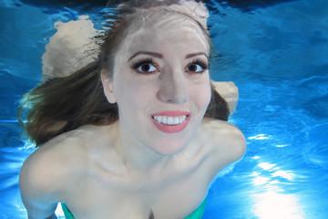 Woman smiling underwater