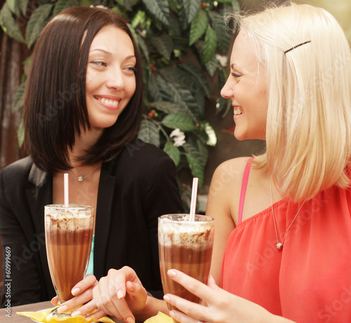 young women having coffee break together