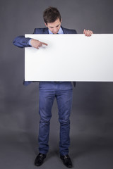 Businessman holding blank table for text